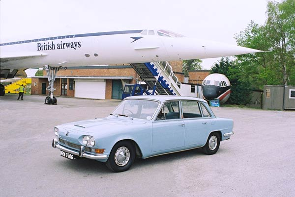 Triumph 2000 Mark 1 saloon in front of Concord jet airliner